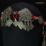 """Mid 20th century. Silver (niello decorations), coral, agate and glass beads on cotton band; grams 155,8 (5.50 oz.). The piece is cm. 74,0 in lenght (29.13″); the decorated part is cm. 37,0 in lenght (14.57″).  Berbers are the indigenous ethnic group of North Africa. They are continuously distributed from the Atlantic to the Siwa oasis in Egypt, and from the Mediterranean to the Niger River. The name Berber appeared for the first time after the end of the Roman Empire. Many Berbers call themselves some variant of the word imazighen (singular: Amazigh), possibly meaning """"free people"""" or """"free and noble men"""". Today, most Berber-speaking people live in Morocco and Algeria.  morr21"""